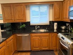oak kitchen cabinets with stainless steel appliances beautiful complete wood custom wood mode kitchen stainless steel appliances bar granite counters green kitchens