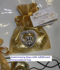 anniversary favors gold 50th anniversary bag filled w chocolate almonds