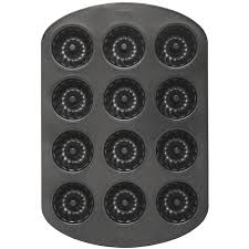 Halloween Cake Tins by Amazon Com Wilton Mini 12 Cavity Fluted Pan Muffin Pans Kitchen