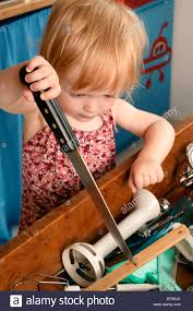 kitchen knives for children toddler with a knife in the kitchen stock photo 21737714
