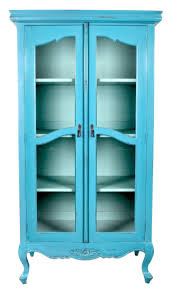 turquoise tall narrow cabinet with glass door in classic chic