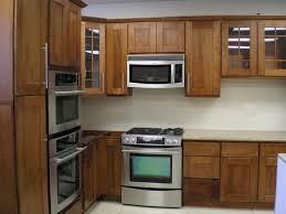 Modern Oak Kitchen Cabinets Kitchen Brown Wood Flooring White Hanging Lamps Brown Wood