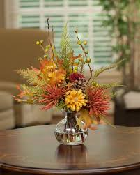 decorating seasonal silk flower arrangements with round table and