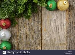 pine needle and ornaments on a rustic wood background