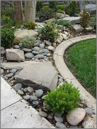 wolverine hosta used river rock as a border to retain soil and