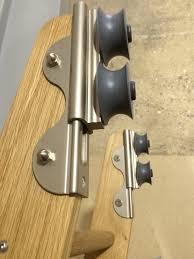 high quality sliding ladder hardware fitted to custom made oak ladder