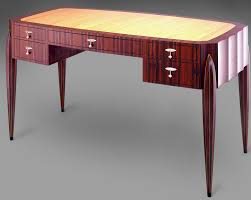 desk with pear top and ten sided tapered torpedo legs art