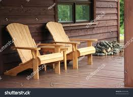 cabin porch adirondack wood chairs on cabin porch stock photo 80297446