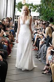deep v neck sleeveless floor length ivory lace wedding dress