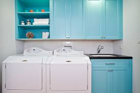 cottage blue laundry room with turquoise washer and dryer