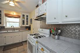 Brushed Nickel Backsplash by Watching The Garden From An Updated Oak Forest Abode Swamplot