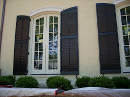 colonial shutters exterior and traditional interior storm panels