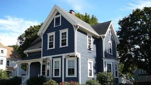 blue house white trim the pros and cons of different house siding angie s list