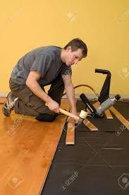 installing tongue and groove hardwood floor stock photo