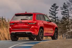big red jeep extreme machine jeep grand cherokee trackhawk the most powerful