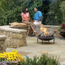 How To Build A Stone Patio by Build A Flagstone And Stone Block Patio Family Handyman