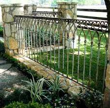 an ornamental iron fence opens up the view to your well manicured