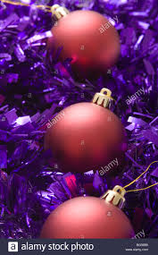 the essence of christmas decorations three red baubles and purple