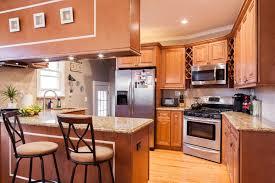 Mocha Kitchen Cabinets by J U0026k Mocha Kitchen Cabinets With Carmel Granite Countertops Kitchen