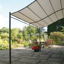 backyard shade ideas with dining table and pavers flooring and
