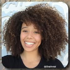 hairstyles for curly hair with bangs medium length 18 best haircuts for curly hair
