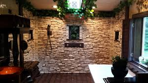 walk in shower with stacked stone creative faux panels
