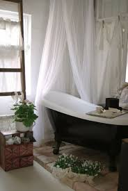 chic small bathroom with black freestanding bathtub and