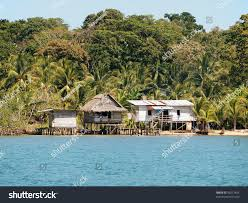 rustic houses on stilts lush tropical stock photo 98272454
