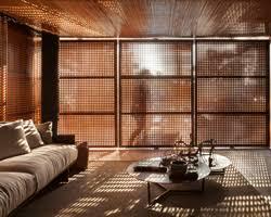 mf arquitetos u0027 wooden screen and garden wall establish interior