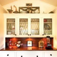 Photos HGTV - Leaded glass kitchen cabinets