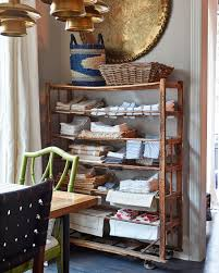 home tour natalie nassar s layered family home how to decorate an antique shoe rack that natalie uses for linen storage