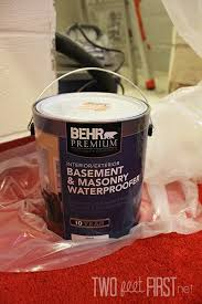 basement organization apply two coats of a waterproofer with