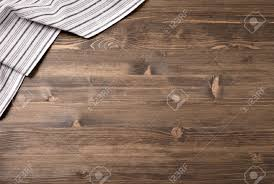 Wooden Table Striped Kitchen Towel From Left Top Corner Of Wooden Table Top