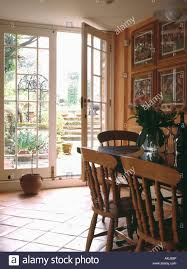 pine furniture in dining room extension with terracotta tiled