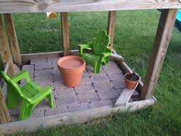 little tea table set pavers under the swingset made a little tea party area for the