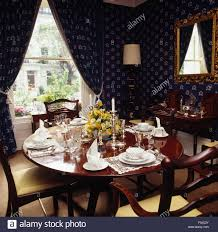 dark blue wallpaper and matching curtains in eighties dining room