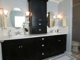 black wooden bath vanity with chrome metal pedestal base using