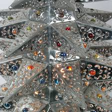lighted punched tin tree with colored marbles