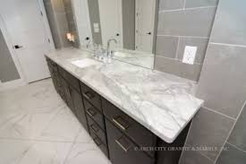 should countertops match floor or cabinets grey and white in the white quartzite countertops