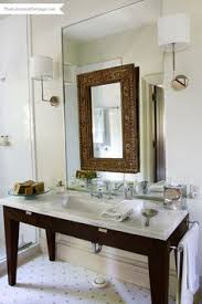 How To Hang A Large Bathroom Mirror - a urinal is included in this basement bath for hurried boys