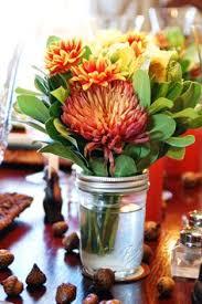 jar arrangements jar flower arrangements lining the aisle miller wedding