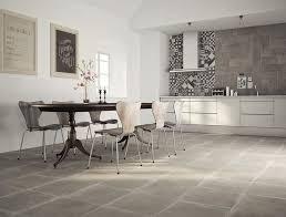 Cement Tile Backsplash by Concrete Wall Tile Notched Troweling Mortar Onto A Concrete Wall