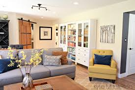 family room with sliding farmhouse style barn door to home office