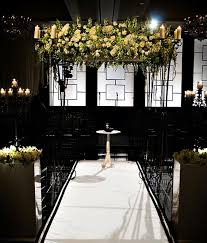 wedding backdrop modern white and green floral chuppah with modern black backdrop four
