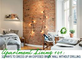 exposed brick wall lighting 10 ways to decorate an exposed brick wall without drilling 6sqft