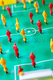 table top football games macro shoot of red and yellow players of tabletop football game