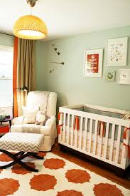 chic nursery glider in nursery transitional with painted furniture