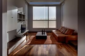 contemporary home design brown wooden shelf behind grey sofa