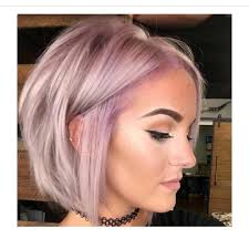 killer pink and lilac hair color atop a beautiful bob haircut by
