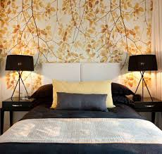 modern bedroom with bedside lamps and autumn leaves wallpaper modern bedroom with bedside lamps and autumn leaves wallpaper